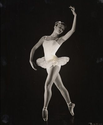 """Carolyn George as the Rose from """"Waltz of the Flowers"""" in Lew Christensen and Willam Christensen's Nutcracker, 1952; Image courtesy Museum of Performance & Design - See more at: http://www.sfballet.org/tickets/nutcracker/nutcrackermeans/dance_vintage?utm_source=facebook&utm_medium=socialmedia&utm_campaign=nutcrackermeans2013#sthash.Zl0unbX6.dpuf"""