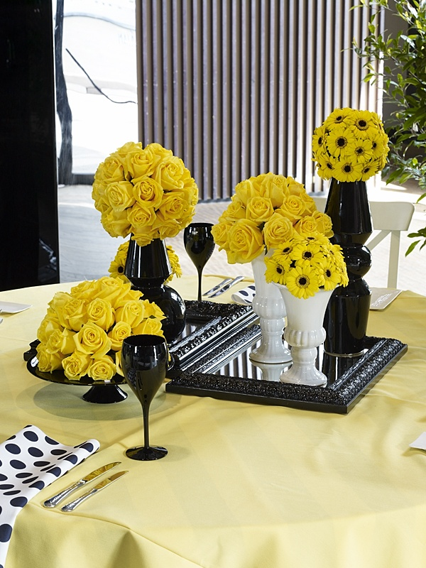 PITTSBURGH STEELERS~Yellow and Black Centerpiece using yellow table linen, black and white polka dot napkins and yellow roses #event #styling #inspiration www.decorit.com.au