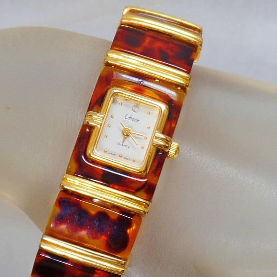 This #vintage tortoise shell ladies watch is absolutely wonderful!  It features a rectangular face with gold tone accents, gold dots for the numbers, a large rhinestone faux... #ecochic #etsy #jewelry #jewellery