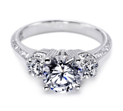 Tacori-Capture everyone's eye with this gorgeous three-stone diamond engagement ring. Channel-set princess-cut diamonds lead up to two petal-like pear shaped side stones to give a big look with some serious brilliance. Diamonds decorate crescent silhouette details for interest from every angle.