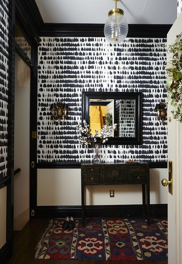 Black walls both ground a space, and provide the perfect backdrop against which other colors really stand out. Bright, sunlit spaces in particular can handle all the darkness, and become cozier instead of claustrophobic. Embrace these 15 moody yet sophisticated wallpaper patterns, and revel in all the drama.
