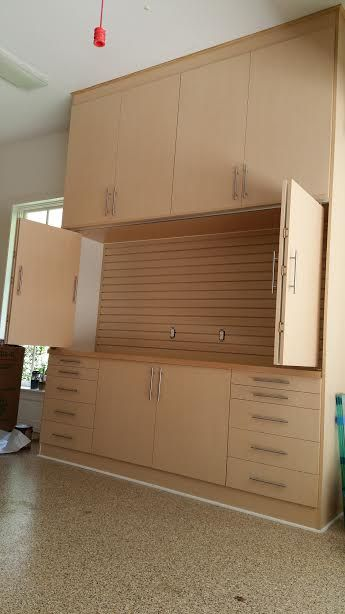 Custom garage storage cabinets from Monkey Bar Storage in Light Maple