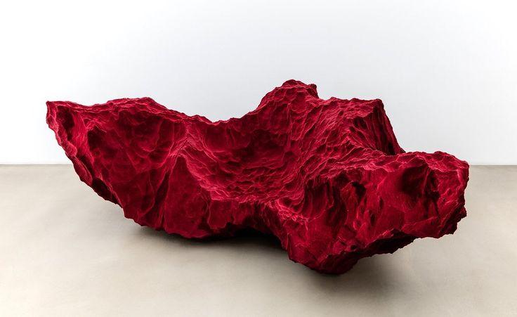 Red sofa. 3D sculptural clad in velvet. Designed by Fredikson Stallard at David Gill Gallery.