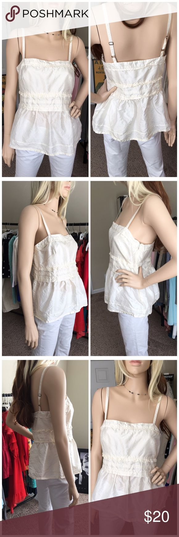 J. Crew 100% Silk Strappy Top Super cute Strappy blouse by J. Crew size 4. Cream color with 100% Silk. Adjustable straps.   No visible rips, holes or stains. The condition is very good. J. Crew Tops