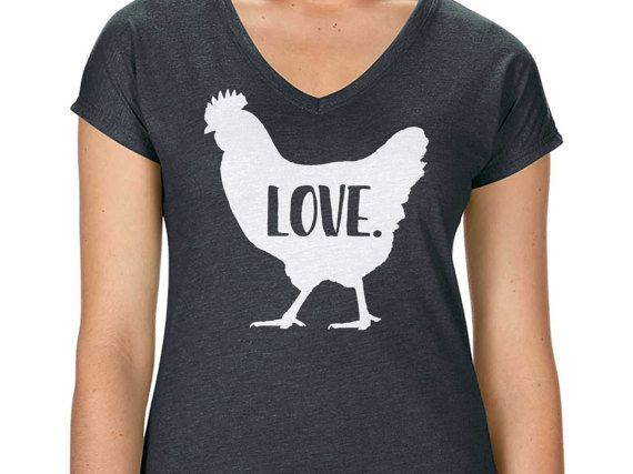 For all the chicken lovers out there, this short sleeve v-neck t-shirt is for you! Shop my designs on Etsy (use coupon code pinterest10 for 10% off your order). #chickenlove #chickenlady #crazychickenlady #chickenshirt #chickengift #chickentank #chickenladyshirt #crazychickenladyshirt #chickengift #backyardchickens #farmgirl #farmlife #chickenlife #spoiledchickens