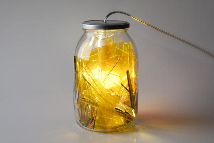 Wzorowo, The group, originally from Wrocław, debuted with a recycling project that put a new spin on glass salvaged from vandalised bus stops. Wzorowo's Broken Glass Jar is a compact fluorescent lamp filled with pieces of broken mirror and glass shards that reflect light in an unexpectedly awesome way. . Photo: Artur Orzeszyna