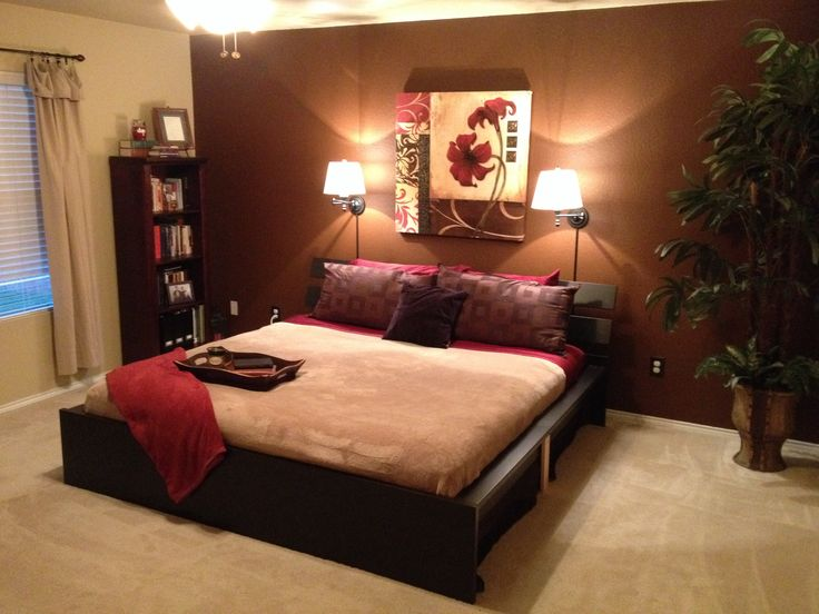 Take a look at this brown living room with alcove shelves ...