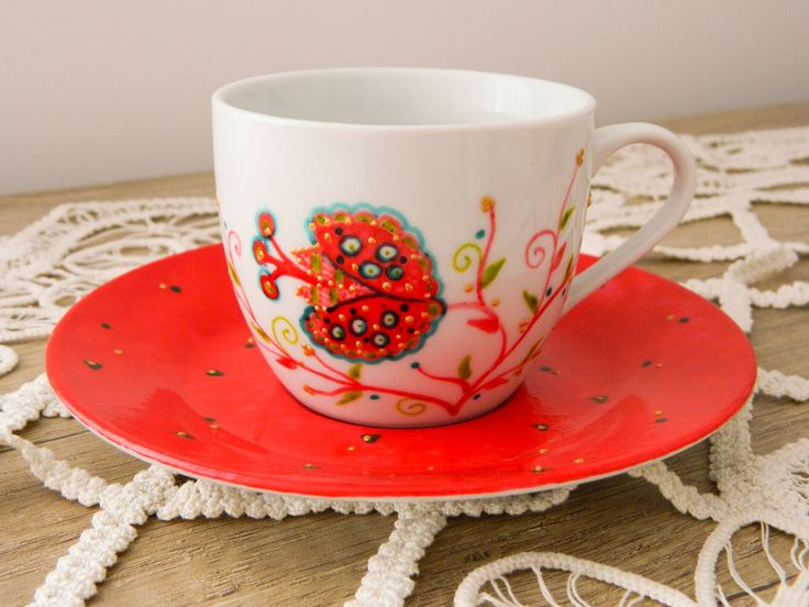 Red tea cup, hand painted with red flower.