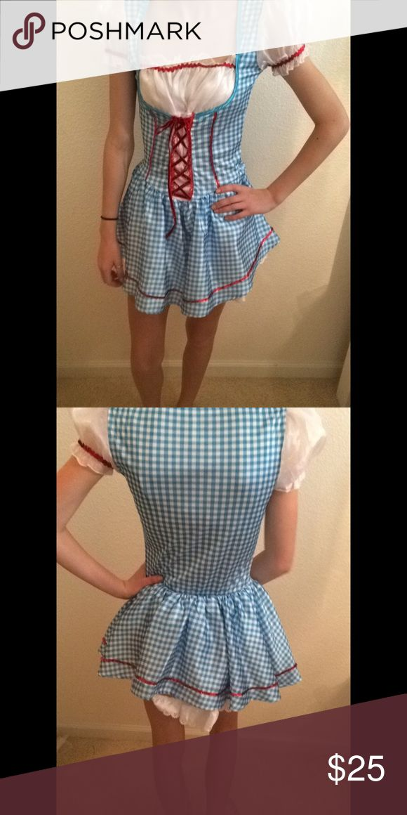 Dorothy Halloween Costume For a shorter girl around 5'3 to 5'4. Never worn, model is 5'6 Spirit Halloween Other