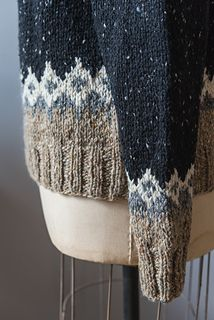 """The sleeves and body of St. Brendan are knit in the round, then joined at the underarm. The sweater is designed and sized to be unisex. For a woman's sweater, you may wish to check the sleeve length after all increases are worked in order to shorten the sleeve length. The yoke is worked in the round, and finished with a simple K1, P1 Ribbing. The sample size shown is the 38"""" (96.5), shown on a model with a 34"""" (86 cm) bust."""