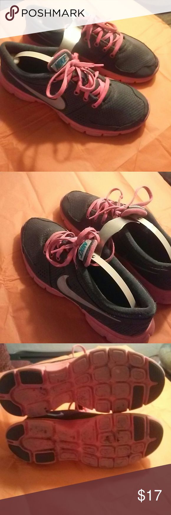 Nike Flex Grey and hot pink tennis shoes Used size 8 Nike flex. Decent condition. Pre worn tennis shoes. Grey and hot pink with hot pink leases. . no rips or tears in fabric. No discoloration. Women's Nike Flex. Extremely comfortable . light weight shoe. Good soles. Nike flex Shoes Athletic Shoes