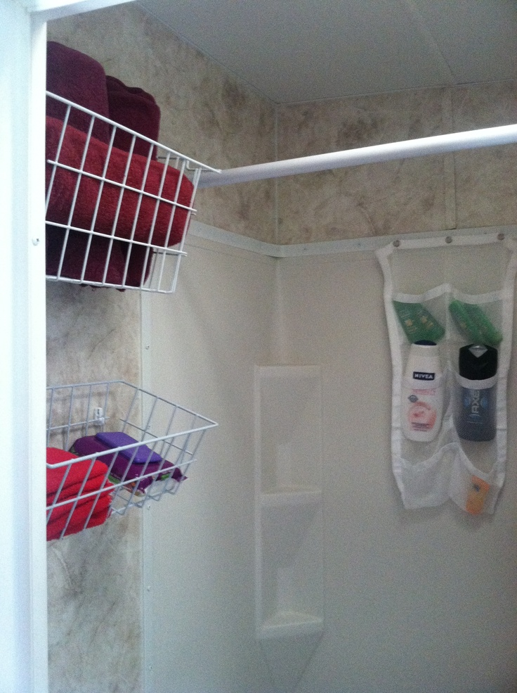 RV bathrooms: freezer baskets attached with wire shelf fasteners and anchors. mesh shower organizer attached with cup hooks