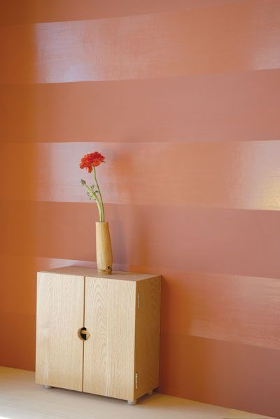 This alluring wall's glossy surface reflects light, and the flat finish absorbs it, giving the illusion that the paints are two different colors.