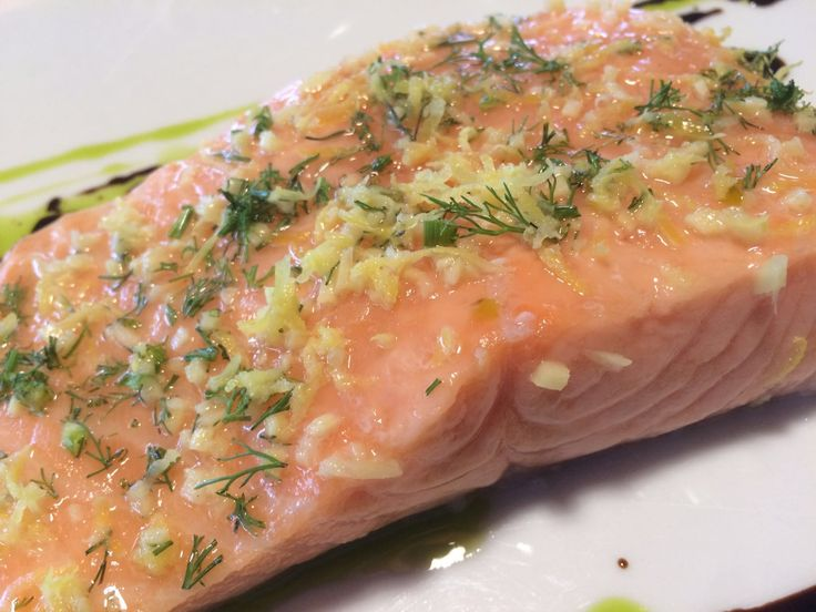 Salmon with herbs and wild fennel, cooked at very low temperature.