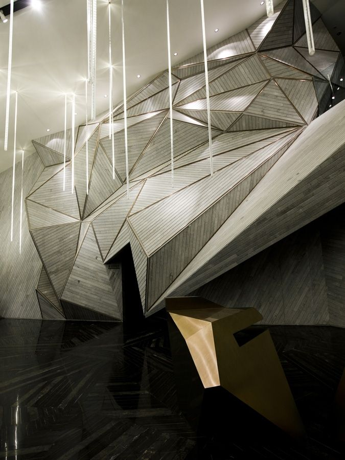 incredible wall and desk detail..  Mountain city sales office, china