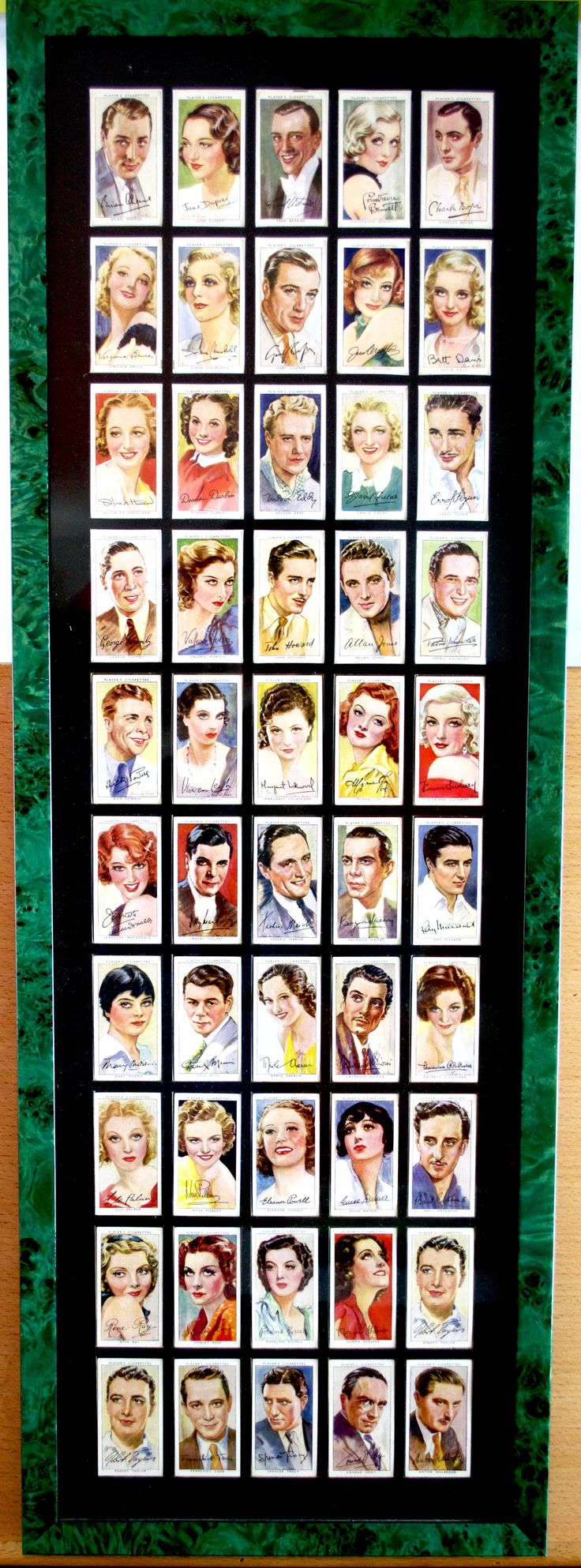Complete framed set of 50 Players 'Film Stars' cigarette cards series three from 1938