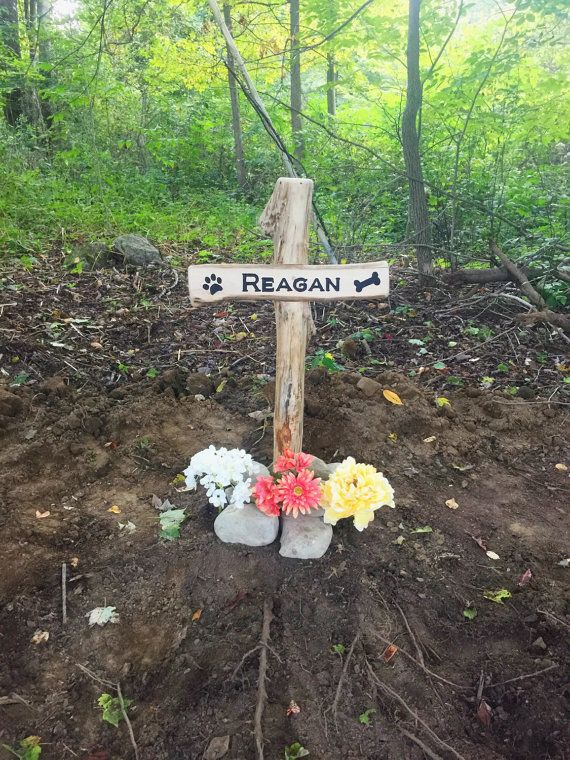 Pet Grave Marker Made of solid wood branches, engraved and lettering is painted black. Has metal rod attached to bottom of grave marker to stake in the ground. This item has a clear gloss finish. Dimensions: Approx. 2.5 ft high X 1.5 ft wide This item is CUSTOM MADE. Not every