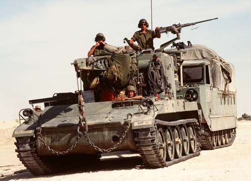 An M-578 light armored recovery vehicle tows an M-548 during Operation Desert Shield, 1 April 1992.