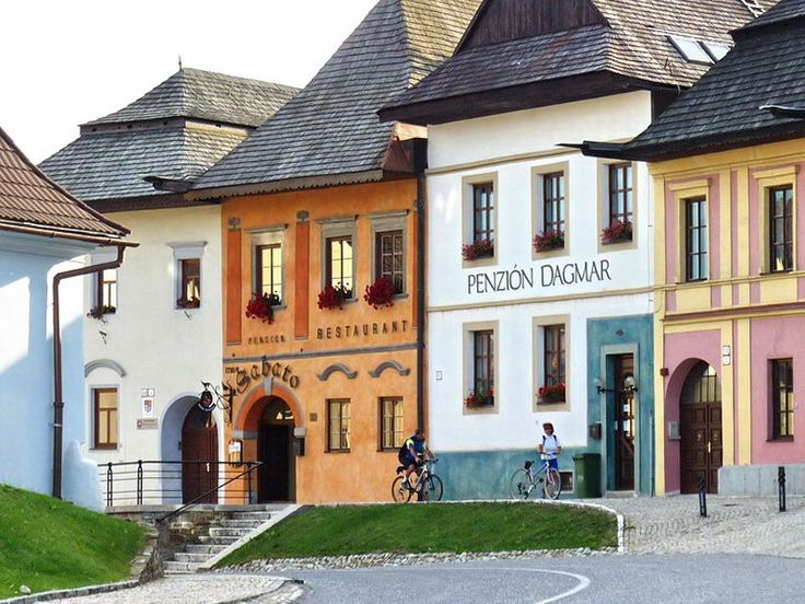 An example of a typical architecture of slovak houses from 18th to the beginning of 20th century. These three floored, six-window-facade and front entrance have been built in towns. Country ones had usually two floor, two facade windows and side entrance.