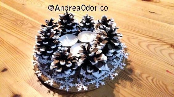 Centrotavola con pigne e candele. Pinecones and candles centrepiece.