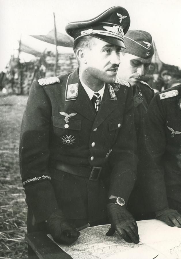 ■ Adolf Galland showing his Spanienkreuz (Spanish Cross) on his rigth pocket.