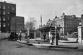 Without the filling station our cars would go nowhere, and one of the earliest stations to open in London was this Anglo-American Oil Company one on the Euston Road in 1922. The kiosk and pumps are unmistakable, though the sweep of the route through is not something we see often today. This picture was taken by Bedford Lemere whose work is now held by English Heritage.