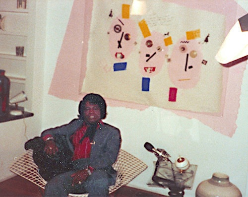 """James Brown in Allee Willis' home in front of her """"Dialated Pupils/ Goodbye"""" painting.  http://www.alleewillis.com/"""