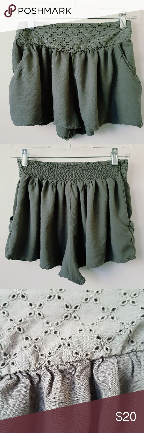 American Eagle Outfitters Military Green Skort Cute and Pleated Skort by American Eagle Outfitters. Has Adorable Perforated Waist Band and Pockets. Nice and Stretchy! Perfect with Strappy Sandals and a White Top. American Eagle Outfitters Skirts