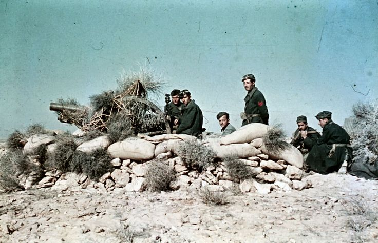 Italian artillery position with 75/27 06 gun covered with bushes as camo in the desert. Photo taken during General Erwin Rommel's Campaign in North Africa, 1941