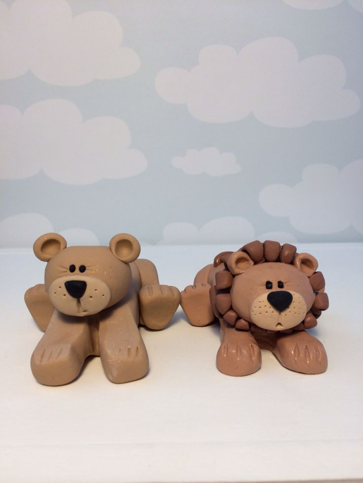 Polymer clay lion and lioness wedding toppers (created by Kelly Bouchard)