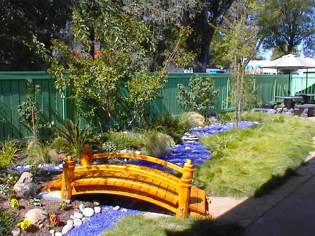 "Not really a ""bridge"" person but I like the faux river look: Gardens Ideas, Backyard Ideas, Backyard Landscape, Rocks Gardens, Gardens Home, Backyard Gardens, Ornaments Grass, Deep Blue, Blue Stones"