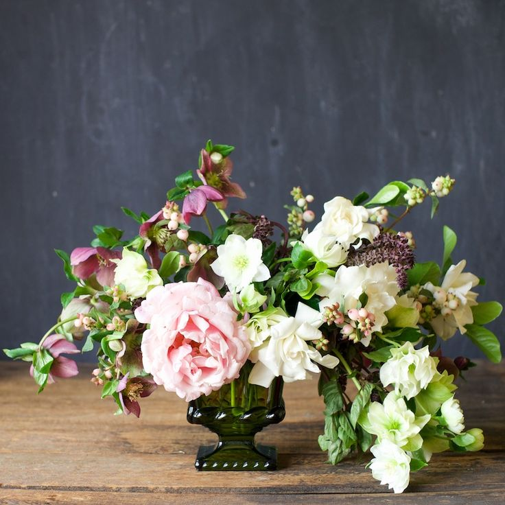 romantic rose, gardenia, hellebore and snowberry arrangement by Tulipina