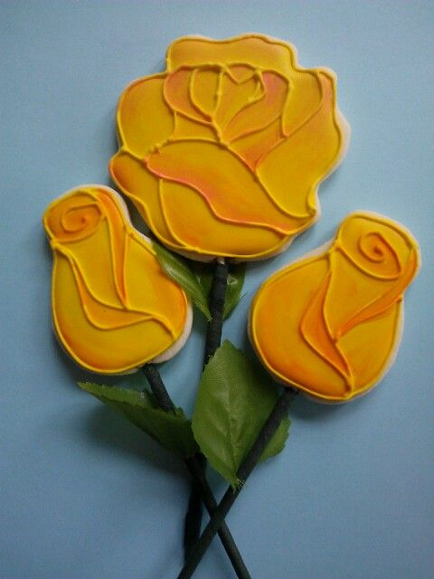 Flower sugar cookies.  Note the cookie sticks are dyed green!  Love it!