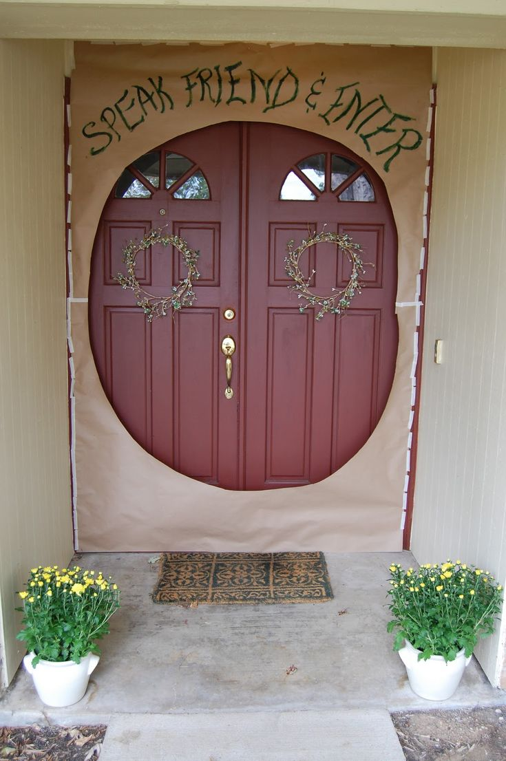 Lord of the rings birthday party door.... but they're mixing their LOTR doors. There's dwarf and hobbit going on there... I'm concerned.  still, it's awesome!!!