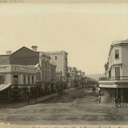 """Rundle St,Adelaide in South Australia (now Rundle Mall) looking east from King William St.Bee Hive corner is on the left. Joel Moss's """"Temple of Fashion"""" is on the right corner."""
