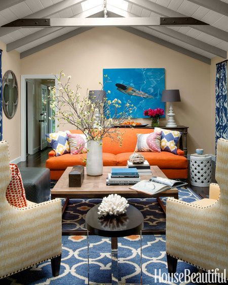 """""""I love the warmth of orange,"""" says designer Matthew Leverone, who covered the living room sofa in a Menlo Park, California, house in Sanderson's Liffey."""