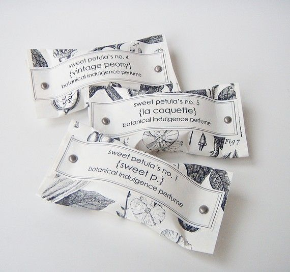 botanical perfumes in little pouches. (i should trademark this design!)