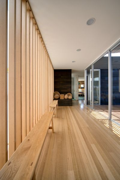 Pale timbers inside offer a pleasing contrast to the dark stained timber on the house exterior. A palette of warm, honey timber tones runs throughout the extension, including 100-year-old Tasmanian oak timber flooring,