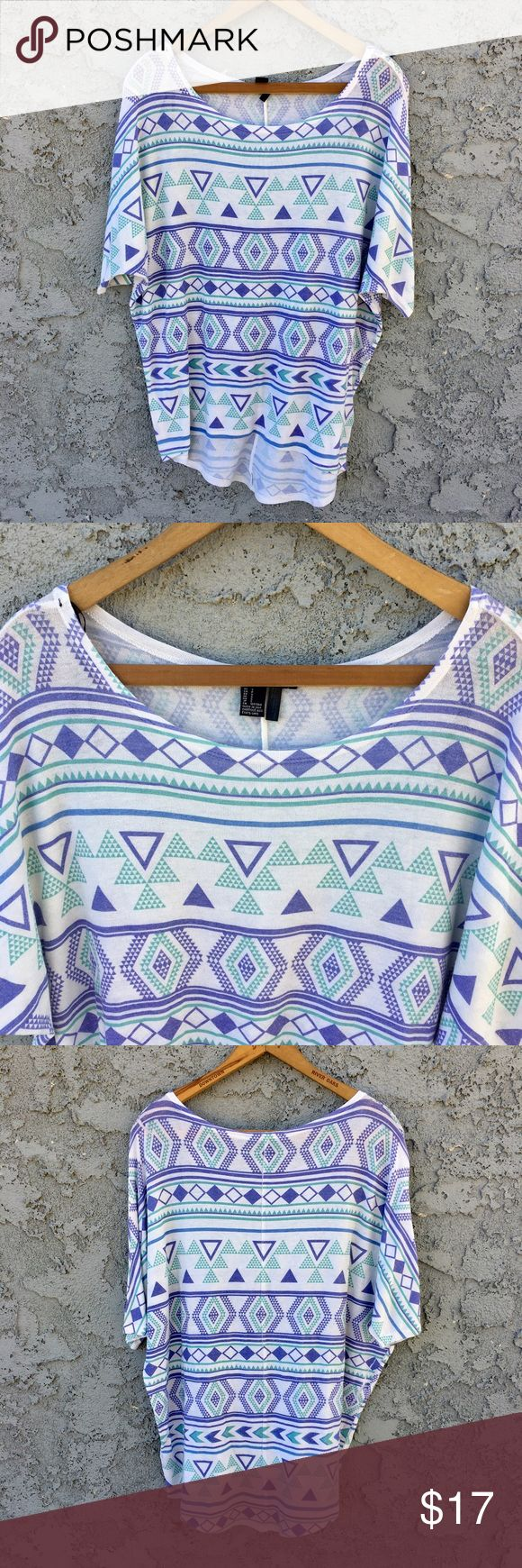Aztec Print Top Forever 21 aztec print top. Slouchy, comfy fit. White color with teal and purple pattern. Great with leggings! In great condition!  ✨ 20% Bundle Discount  ✨ Accepting Reasonable Offers Forever 21 Tops