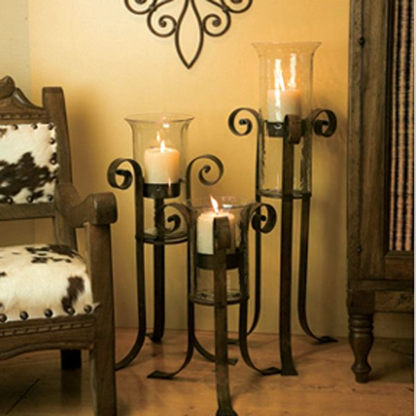 Floor Candle Holders...these would look nice near a fireplace