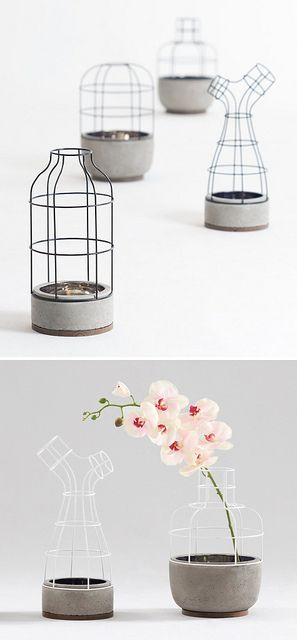V4 is a lovely interpretation of a vase made from iron, concrete and walnut, by Seung Yong Song. I love the heaviness of the concrete bottom contrasted with the light wire frame top.