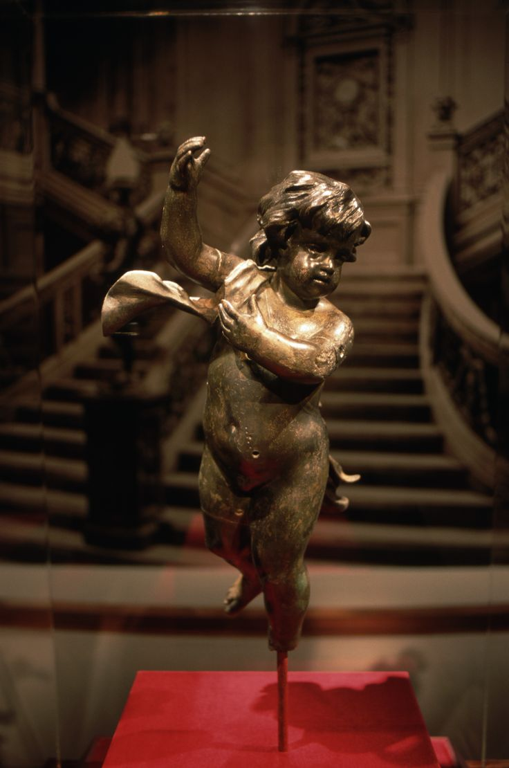 Recovered Cherub Figure from the Titanic: This cherub was recovered from the wreckage. (Photo Credit: Todd Gipstein; RMS Titanic, Inc./CORBIS) @Maggie R. Lynnette ..... CH is a cherub.