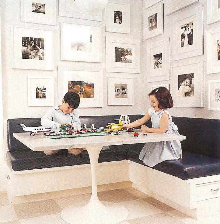 built-in banquette vinyl covered and family photos for art