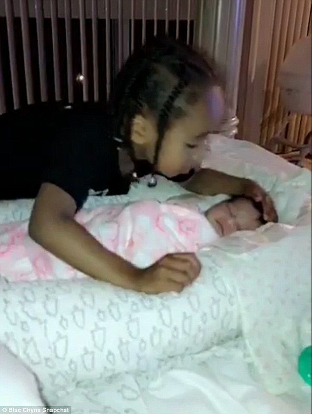 Devoted brother: On Saturday night, his mom Blac Chyna filmed King Cairo, four, leaning over his sleeping newborn sister Dream Kardashian to plant a smooch on her cheek