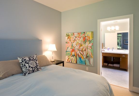 Master queen bedroom featuring an en suite 4 pc bathroom with soaker tub, glass enclosed shower and heated tile floors. Everything you need to have a fresh and easy start in the morning.