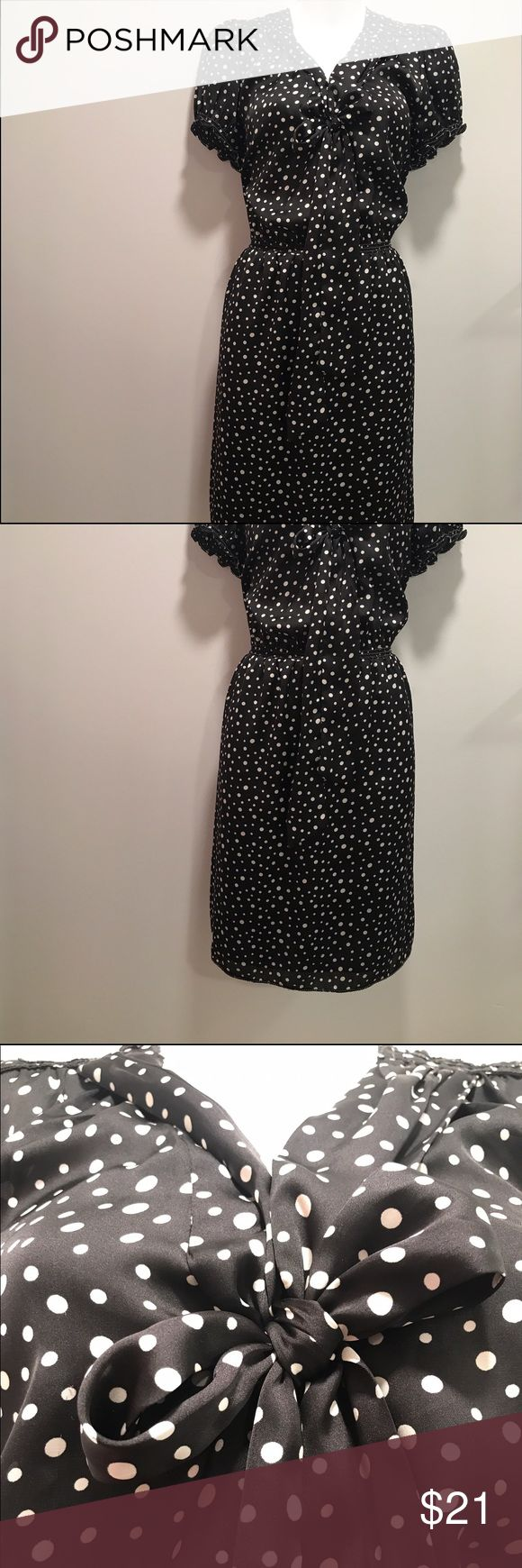 Vintage inspired black and white polka dot dress-L Slip into this flattering yet hug you in the right spots dress. Great for the office and for a night out afterward. It's short sleeve and has a beautiful front tie bow. It is comfortable and beautiful. Don't let this LBD get away! In pristine condition. No holes or stains. Ruffle and the waistline stretches! Max Studio Dresses