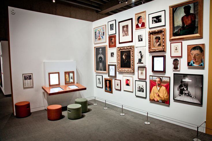An example of user-generated-content (UGC) in OMCA's Gallery of California Art. The Portrait Wall illustrates how to integrate visitor-made content into California portraiture.  Photo by Michael Cuffe. Courtesy of the Oakland Museum of California.
