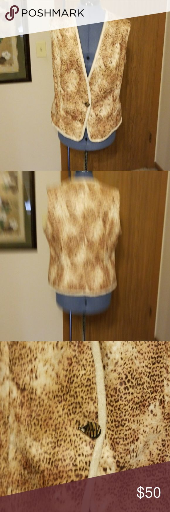 Custom made Suede cloth animal print vest This suede cloth animal print vest is handmade by me. It is fully line with black crape and trimmed in a solid textured suede cloth as well. It is a size 12 and would look great in anyone's fall wardrobe! custom Other