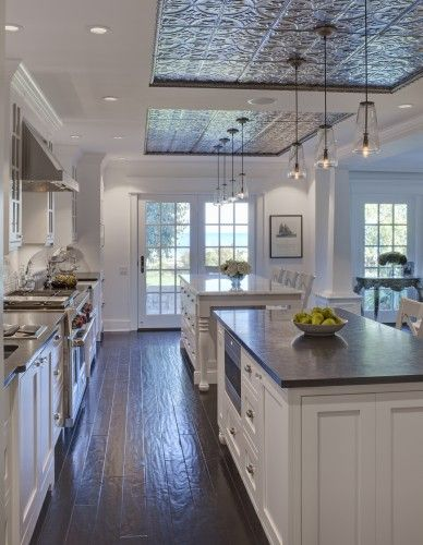 Dream Kitchen, double island, rustic wood floor, tin ceiling accent, beautiful pendant lights, classic white cabinets with neutral countertops. Even the windows are beautiful!