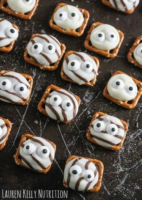 Googly Eye Pretzel Kisses: These mini treats require just three ingredients — pretzels, Hershey's Kisses, and candy eyes. Once complete, you can pop them right in your mouth and go!Find more easy, quick and tasty DIY Halloween party snacks here.